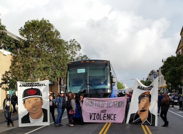 Photos of Amilcar Lopez Perez and Alex Nieto flank a blocked eBay Bus. Photo by Daniel Hirsch.