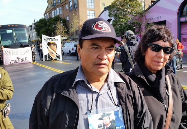 Refugio (left) and Elvira Nieto, parents of victim of police shooting, at the Mission Station protest. Photo by Daniel Hirsch.