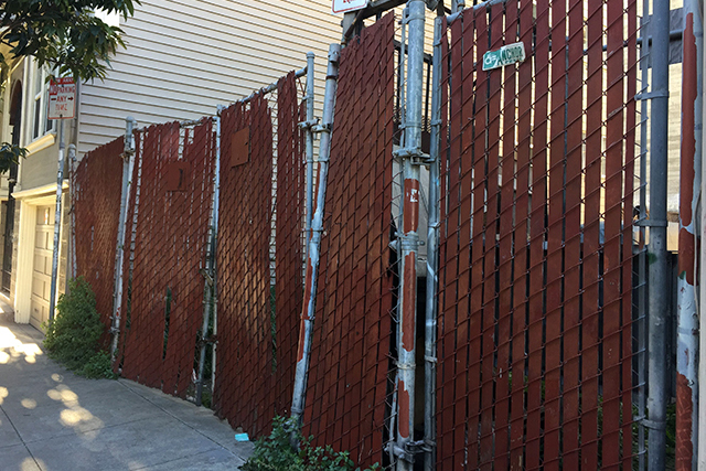 How a raggedy fence can seem like an undulating piece of art at certain times of the day - or maybe moods. Photo by Lydia Chávez