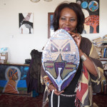 Sala-Haquekyah Chandler holds a shield made by her son Yalani Chinyamurindi.