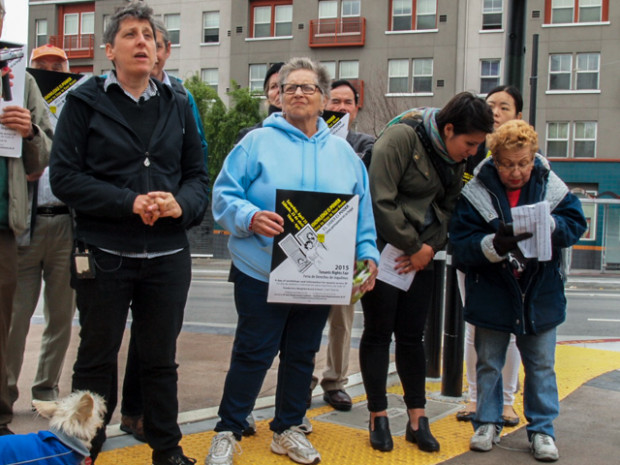 Sara Shortt (left), executive director of the Housing Rights Committee, stands by Mission District tenants while explaining evictions have climbed to 10-year highs without the peak in sight.