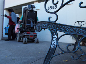 Tenants enter Mission Dolores Senior Apartments at 1855 15th St., near Valencia Gardens.