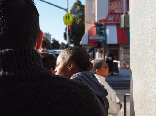 People wait in line in the morning for the Social Security Administration on Valencia at 22nd streets.