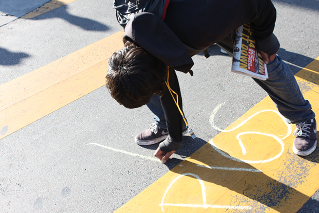 More chalk messages sprang up all over the intersection of Mission and 24th streets, some positive, others slurs. Photo by Laura Wenus