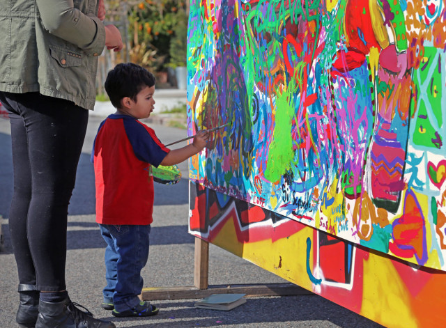 Junior painter. Photo by George Lipp