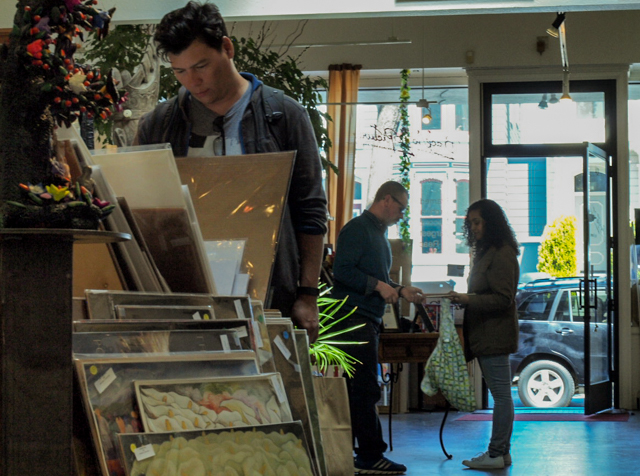 Customers browse in Back to the Picture, a Latin American art gallery and framing shop.