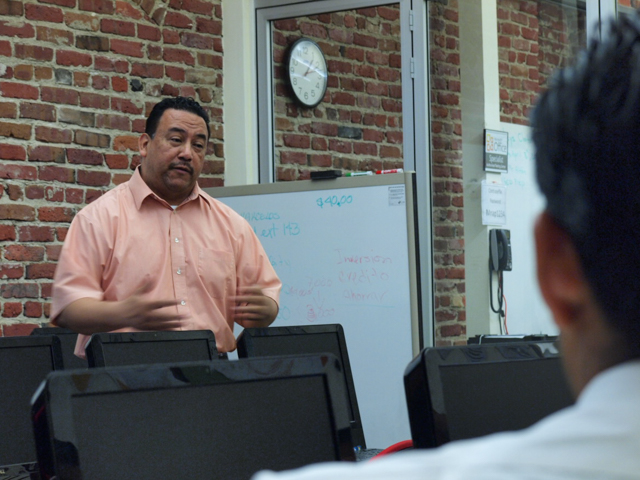 Mission Techies instructor Leo Sosa gives trainees a pep talk.