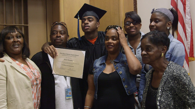 A Five Keys graduate poses with his family. Photo courtesy of filmmaker Annelise Wunderlich.
