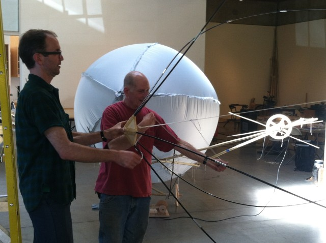 Artist Bernie Lubell (in the red t-shirt) experimenting with a frame for a dirigible. Photo by Joe Rivano Barros.