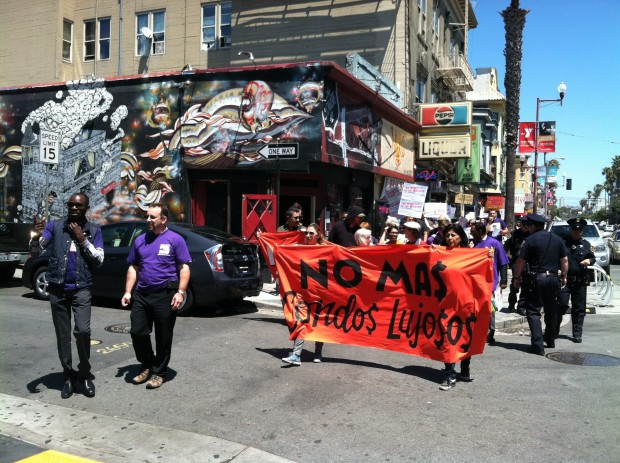 The 70-strong crowd marching down Mission, flanked by police officers. Photo by Joe Rivano Barros.