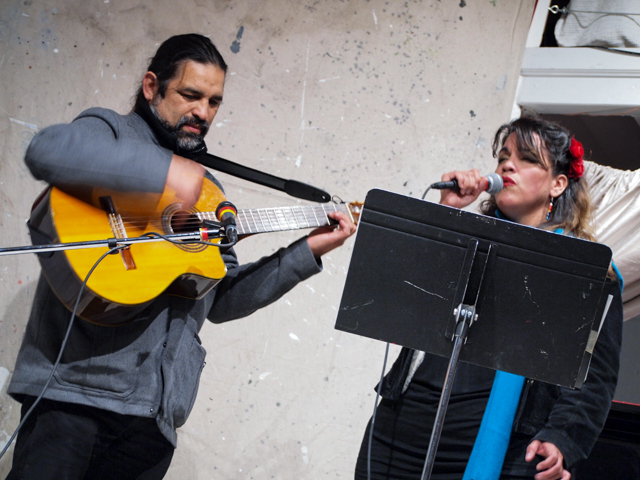 "Francisco and Liliana Herrera performed six songs, including ""Women and the City"" about undocumented female workers. Liliana sang that even when the workers' kids are sick, they're ""afraid to reach for the telephone."""