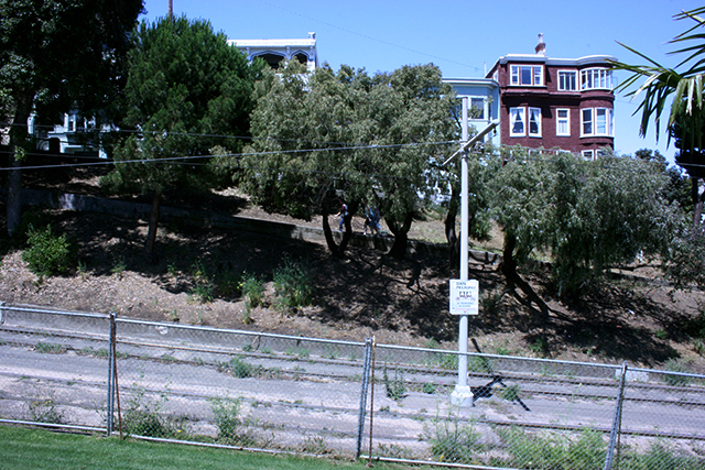 Eventually a permanent fence will separate the park from the tracks.