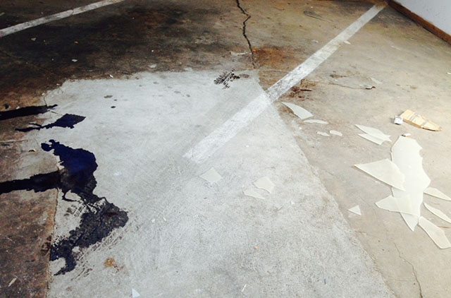 The garage floor where the victim fell. Photo by Meira Gebel