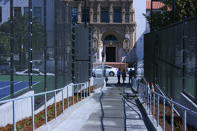 This walkway is intended to be the main point of entry for tennis players. Park managers are working on devising a more efficient queueing system for the courts.