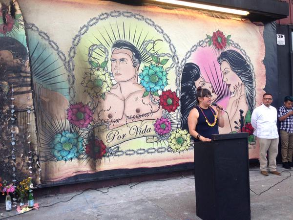 Ani Rivera stands and speaks to the crows in front of the LGBT mural that has recently been defaced four times and torched once. Photo by Meira Gebel.