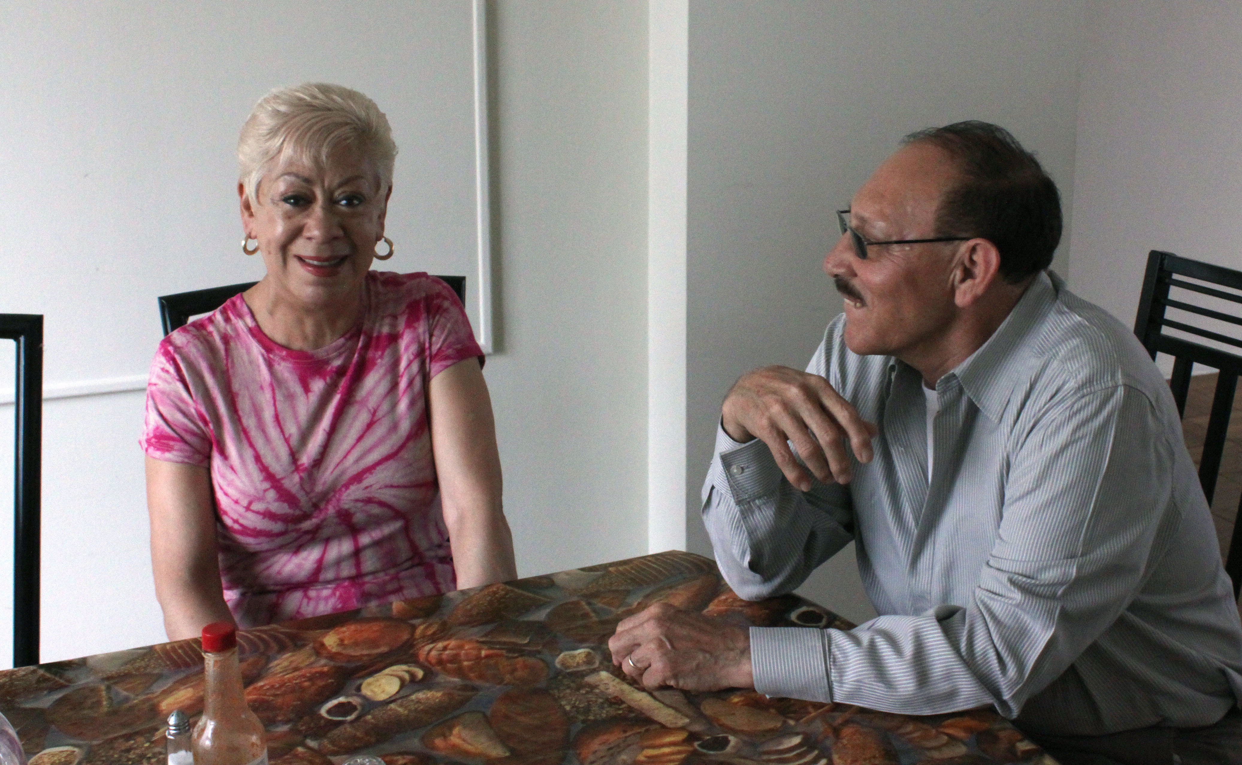 Eugenia Aldama and Humberto Lopez at the dining table in their temporary home in Parkmerced. Photo by Laura Wenus