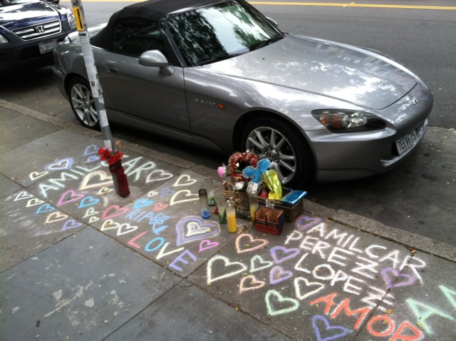 A memorial for Amilcar Perez-Lopez located where he was killed by police, just steps from his old house. Photo by Joe Rivano Barros.