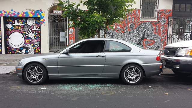 A car on Bartlett Street caught up in the shoot out. Photo by Marta Franco.
