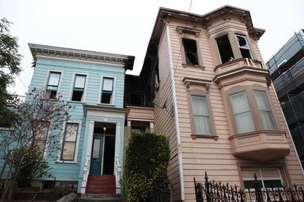 The two affected buildings, 628 Shotwell St. on the right and 634 Shotwell St. on the left, the morning after the fire. Photo by Joe Rivano Barros.