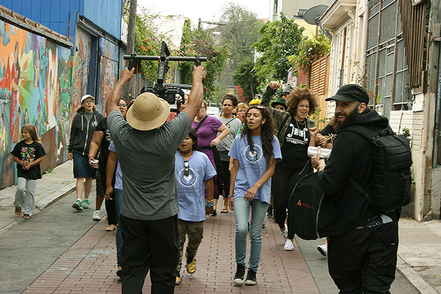 The Mission Girls lead a small crowd down Balmy Alley for a shot in their music video. Photo by Laura Wenus
