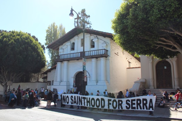 Protesters gathered outside Mission Dolores to decry Pope Francis's decision to canonize Junipero Serra. Photo by Joe Rivano Barros.