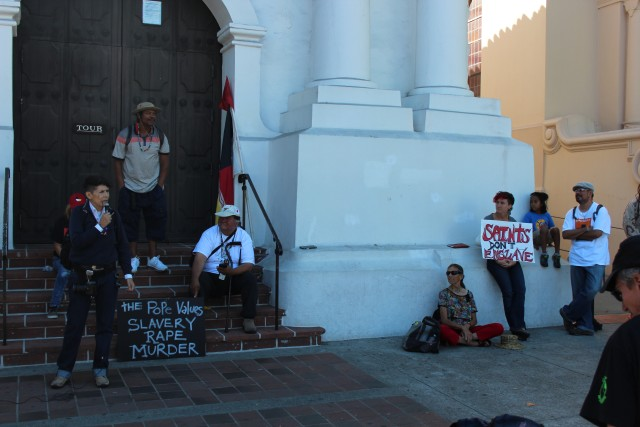 Speakers at the Junipero Serra protest outside Mission Dolores. Photo by Joe Rivano Barros.