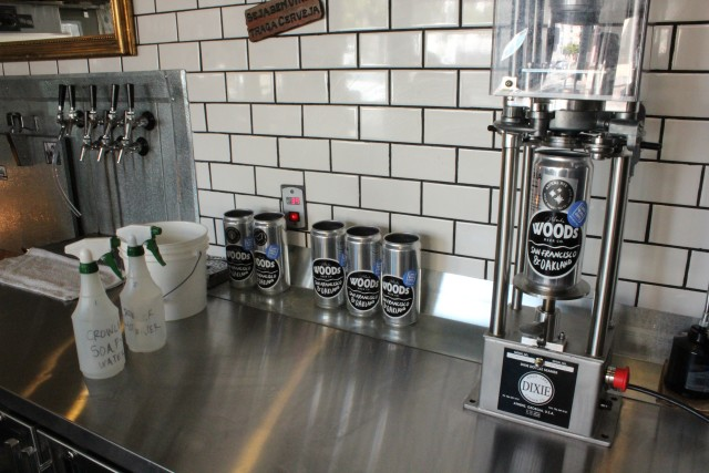 The crowler machine recently purchased by Cerveceria, which has eliminated all bottled beer from its bar. Photo by Joe Rivano Barros.