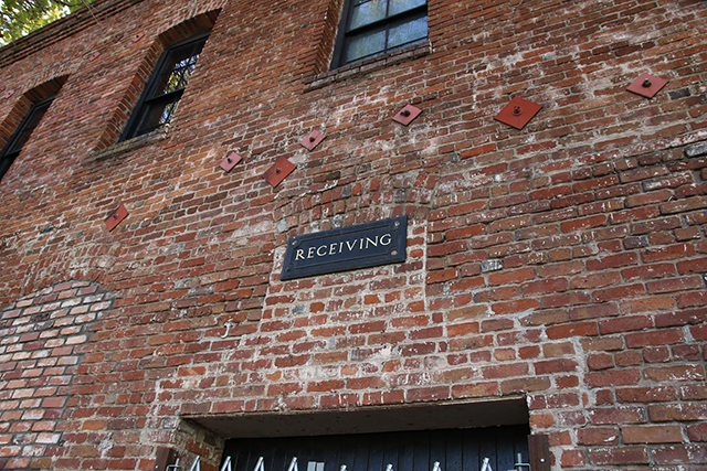 Old factory sign on brick facade of 19th street building. Photo by Janet Kornblum