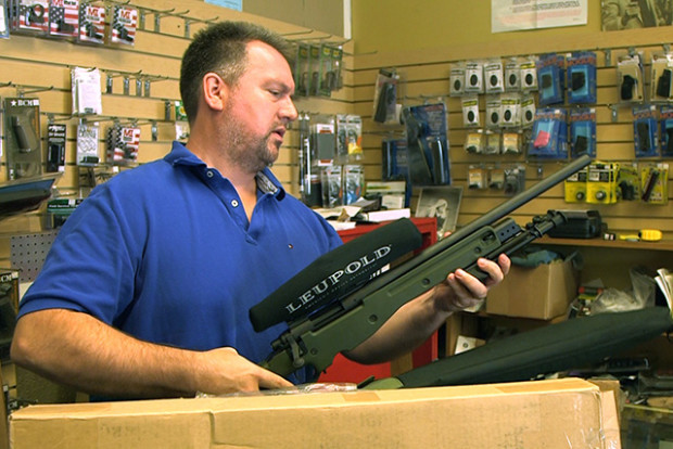 Mike handling a .308 rifle at High Bridge Arms.