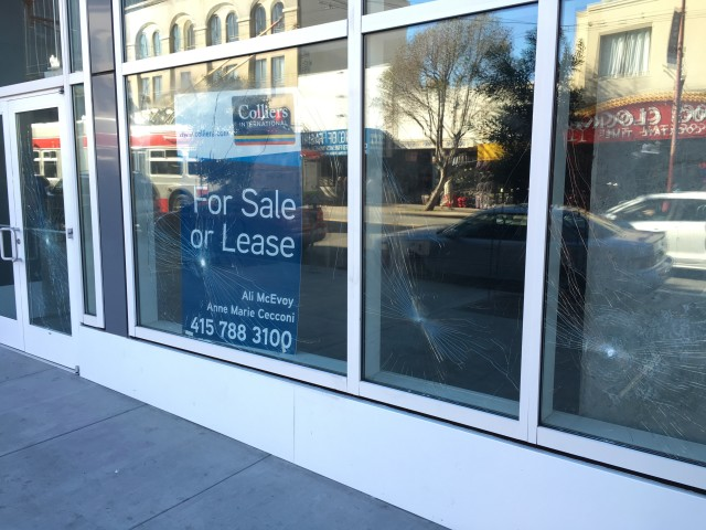 The four windows on Mission Street smashed last week. Photo by Joe Rivano Barros.