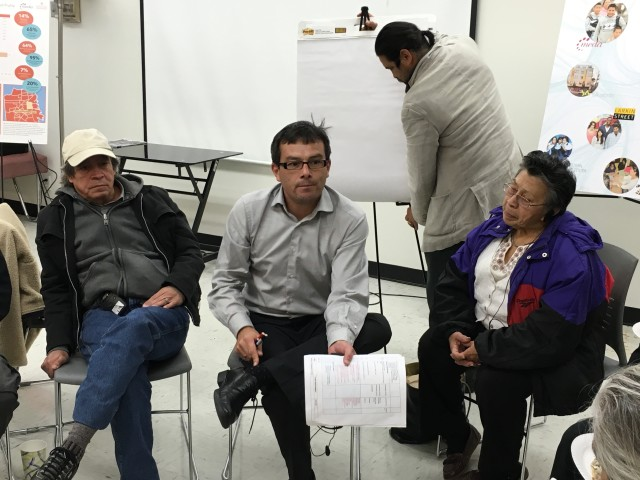 Dairo Romero speaking to a group of locals about the new affordable housing project. Photo: Joe Rivano Barros / Mission Local.