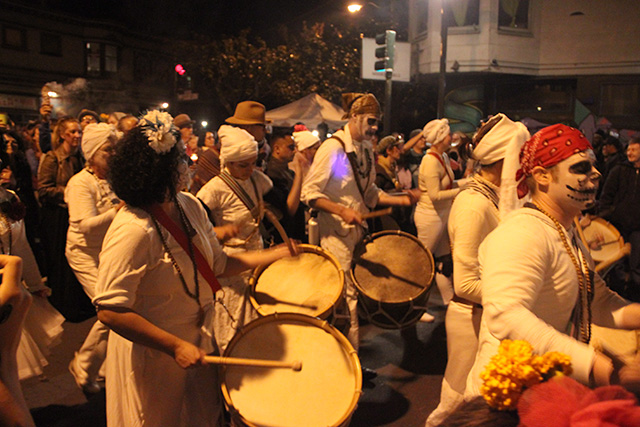 Drummers set the beat of their portion of the procession up 24th Street.