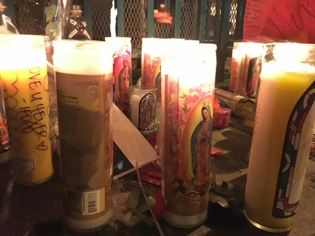 Prayer candles left at the memorial on Capp and 24th streets. Photo: Laura Wenus / Mission Local.