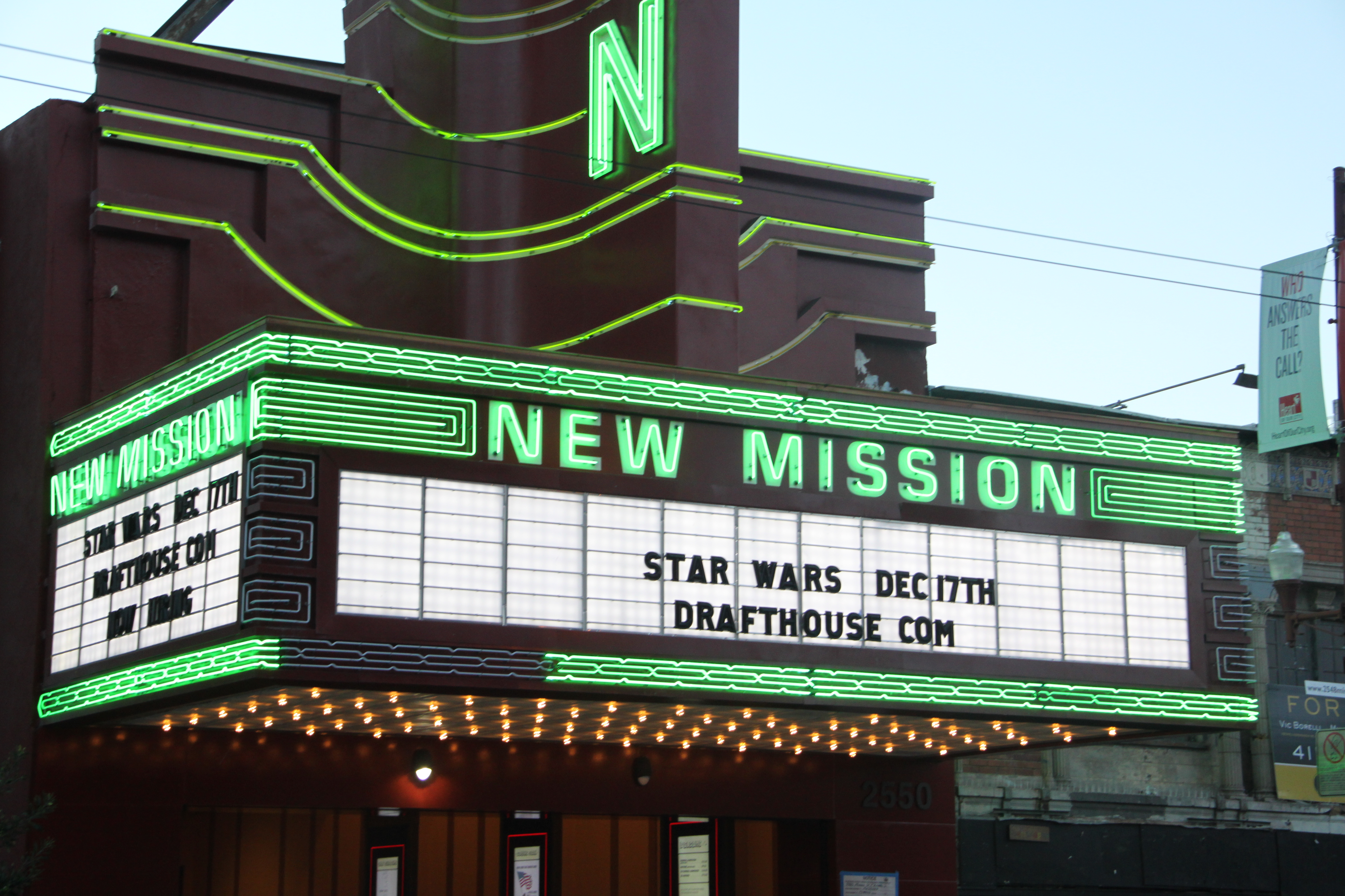 The old marquee, with new neon green lights. Photo: Laura Waxmann / Mission Local.