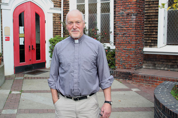 Father Richard Smith stands in the courtyard of Episcopal Church of St. John the Evangelist, at 1661 15th St. Photo By Laura Waxmann