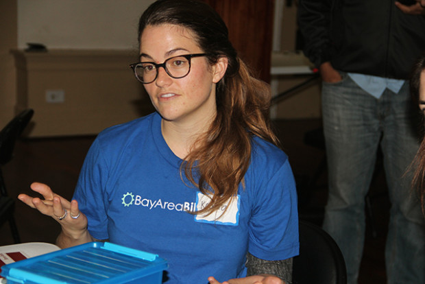 A Bay Area Bike Share staff member explains the program. Photo by Aria Killough-Miller