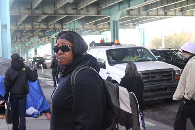 Queen Nandi and other protestors confront DPW employees at the Division Street homeless encampment. Photo by Laura Waxmann