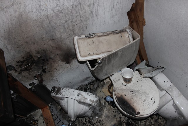 The interior bathroom, smashed and burned by the arsonist. Photo: Joe Rivano Barros / Mission Local.