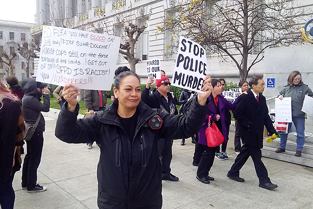 Protestors Decry Woods, Nieto Shootings at Lee's Inauguration