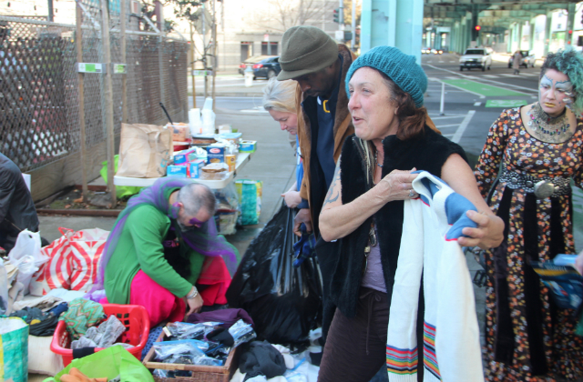 Mamma Donna picking up a sweater at Tuesday's drag queen clothing drive for the homeless. Photo: Joe Rivano Barros / Mission Local.