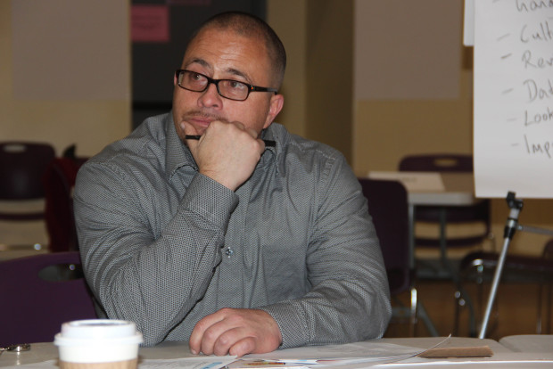 Joseph Calderon listens to a  discussion of the city's justice and law enforcement system at the Women's Building. Photo by Aria Killough-Miller