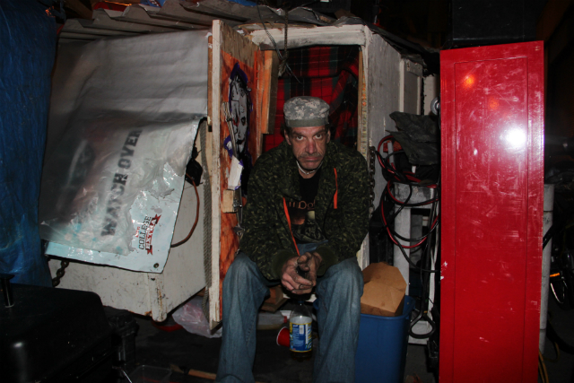 Eddie Tate sitting in his shelter on Division Street, where he said he'll wait until the last minute to move. Photo: Joe Rivano Barros / Mission Local.