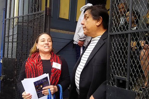 Tracy Parent of the Community Land Trust introduces Rene Yañez, one of the tenants whose evictions was halted as a result of the purchase.