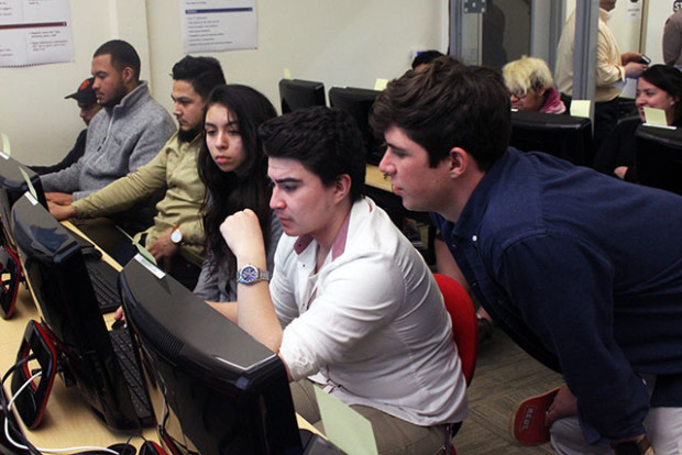 Student's participating in a five-week free coding course hosted at Mission Economic Development Agency on 19th and Mission Streets. Photo by Laura Waxmann
