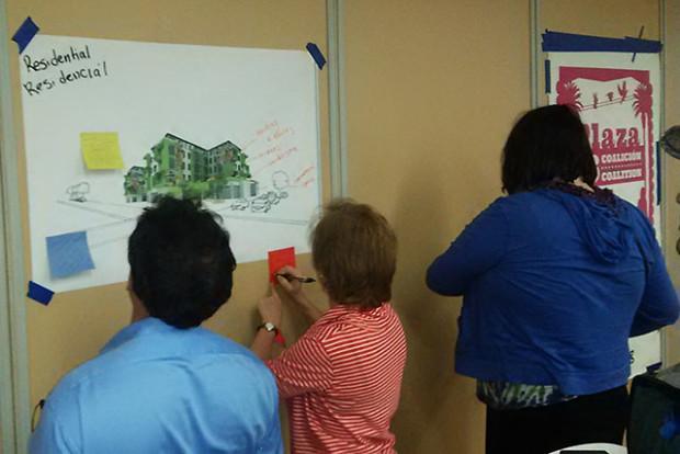 Community members write their feedback on notes. Photo by Laura Wenus