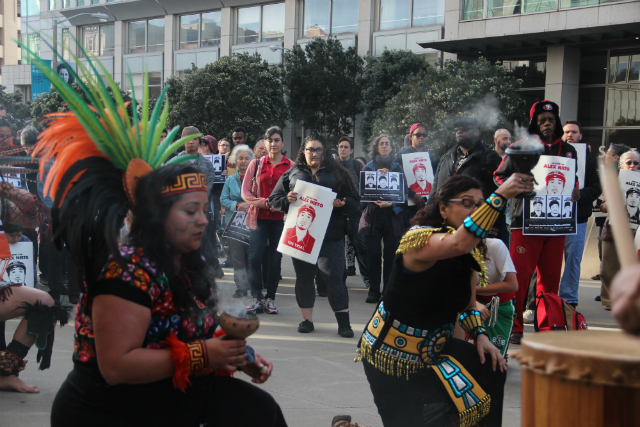 Aztec dancers surrounded by more than 150 people outside the federal courthouse. Photo by Joe Rivano Barros.