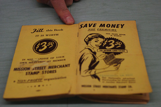 A Mission Merchants savings stamp booklet. Photo by Laura Wenus