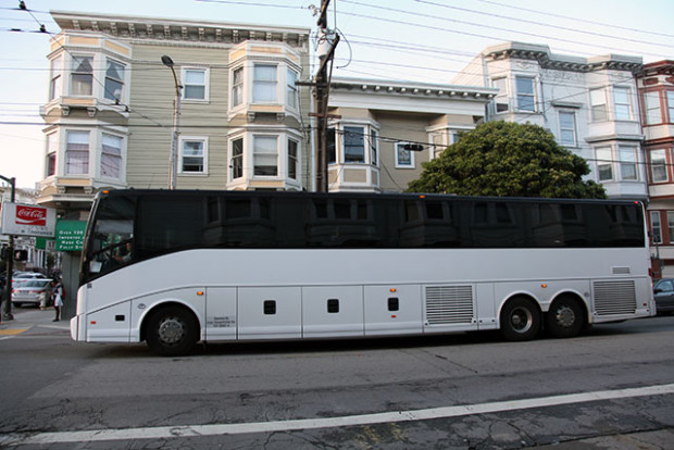 A commuter shuttle bus at the intersection of 18th and Guerrero streets. Photo by Laura Waxmann