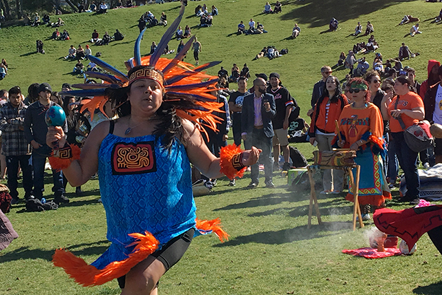 A dancer helps begin the 415 Day celebration. Photo by Laura Wenus