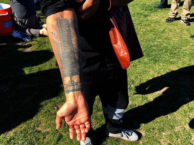 A 415Day reveler shows off his tattoo of the New Mission Theater marquee. Photo by Laura Wenus
